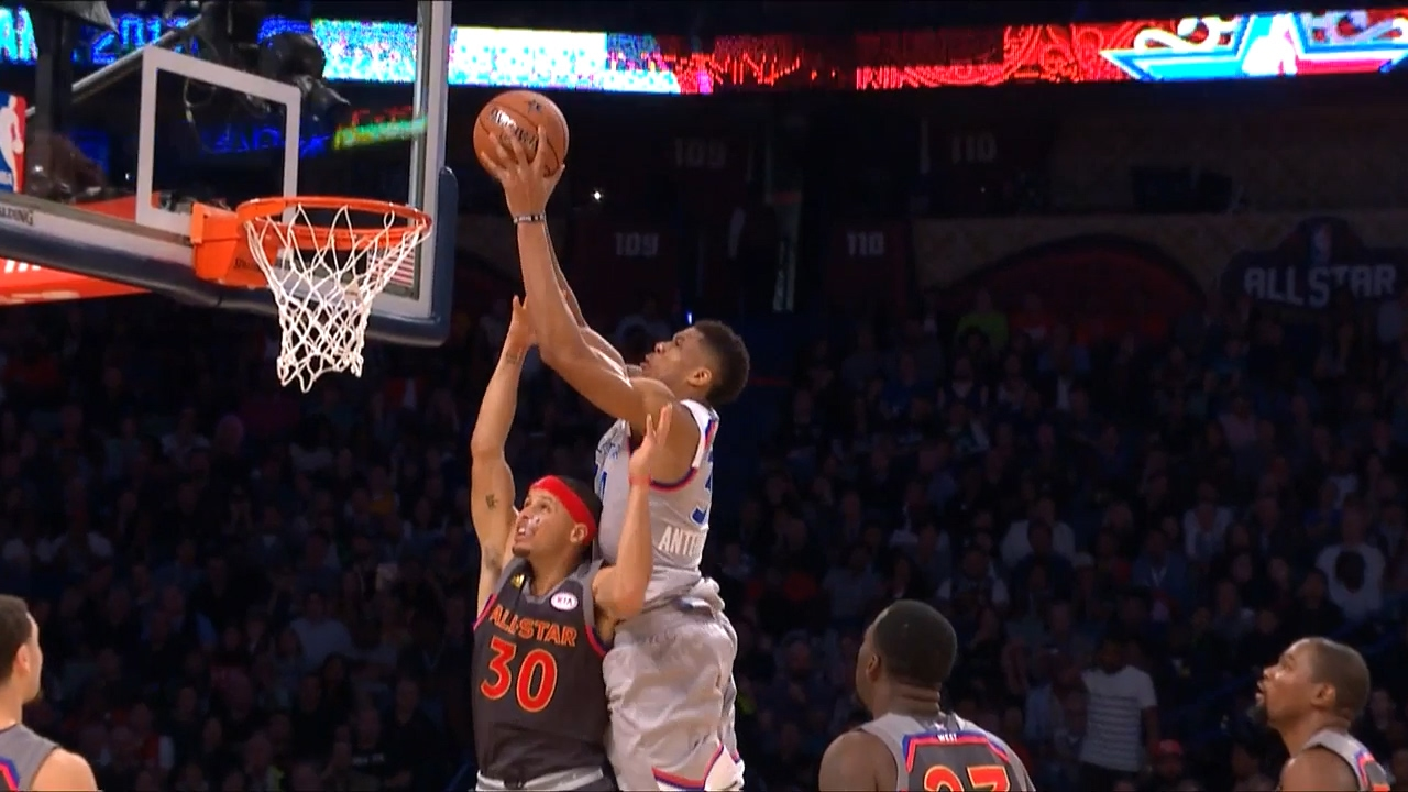 Giannis Antetokounmpo posterizes Steph Curry on a put back slam