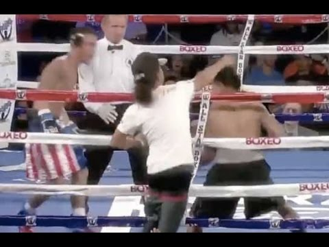 Spectator takes a swing at a Boxer during Live Boxing Match
