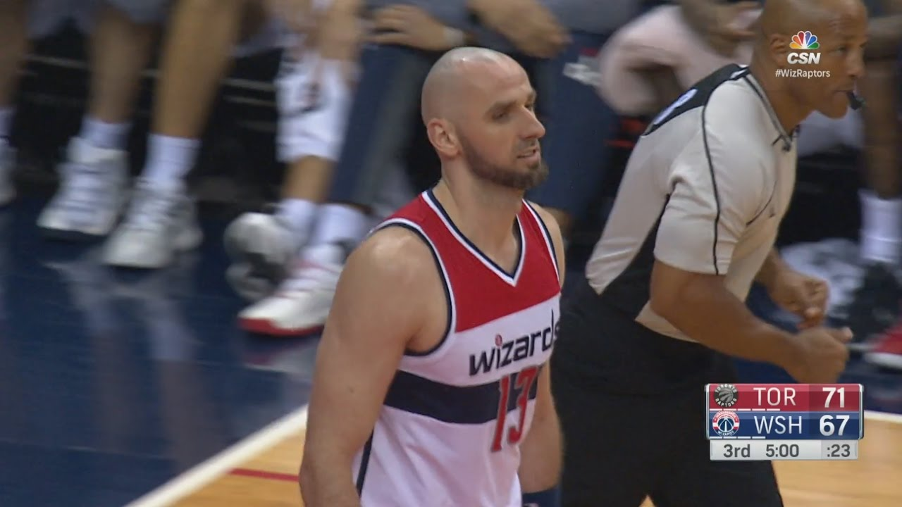 Marcin Gortat tips in a ball on his own basket