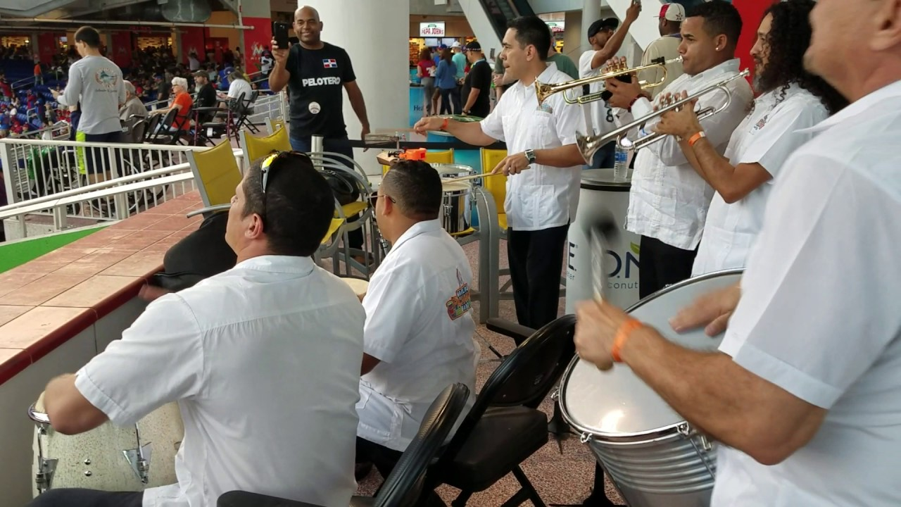Marlins staff play the drums at Dominican Republic WBC game