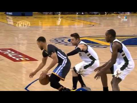 Stephen Curry gets shoved out of bounds by Mathew Delladova