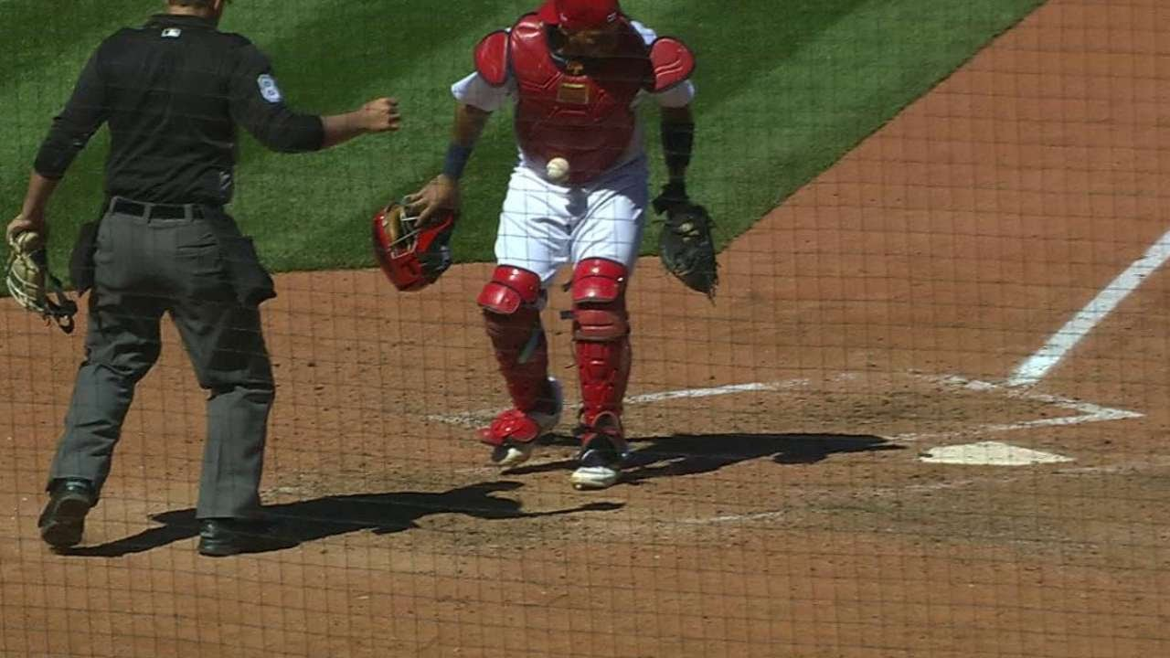 Bizarre: Yadier Molina has a baseball stick to his gear after strikeout