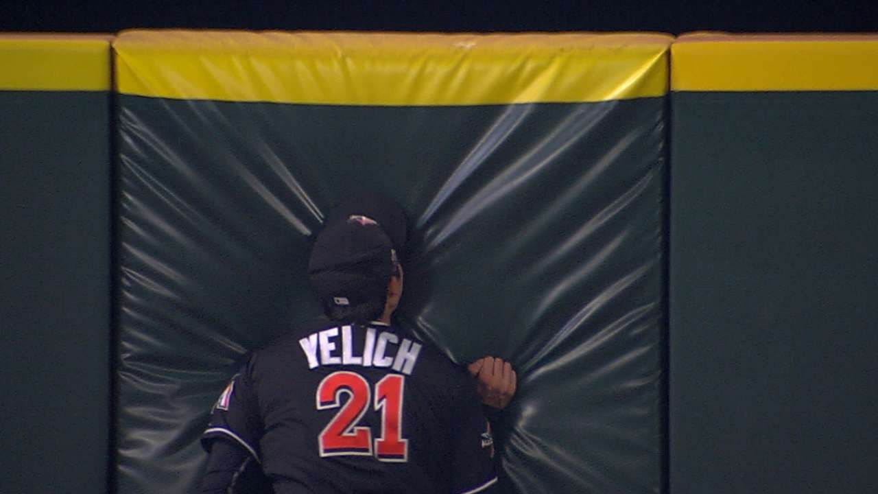 Marlins outfielder Christian Yelich slams into the wall at full speed to make a catch