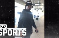 Marshawn Lynch smacks phone out of fan who is filming him at LAX