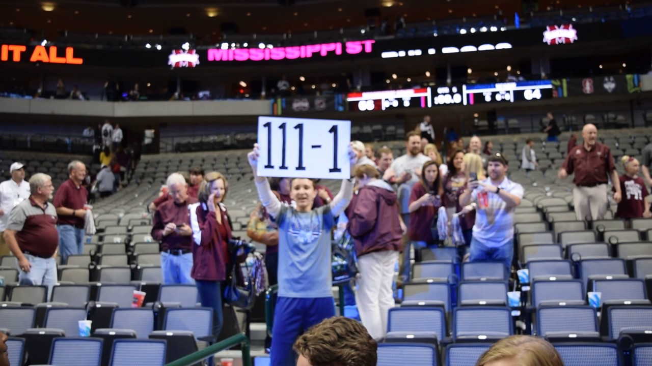 Mississippi State fan holds up