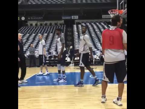 Tony Romo scores in practice with the Dallas Mavericks
