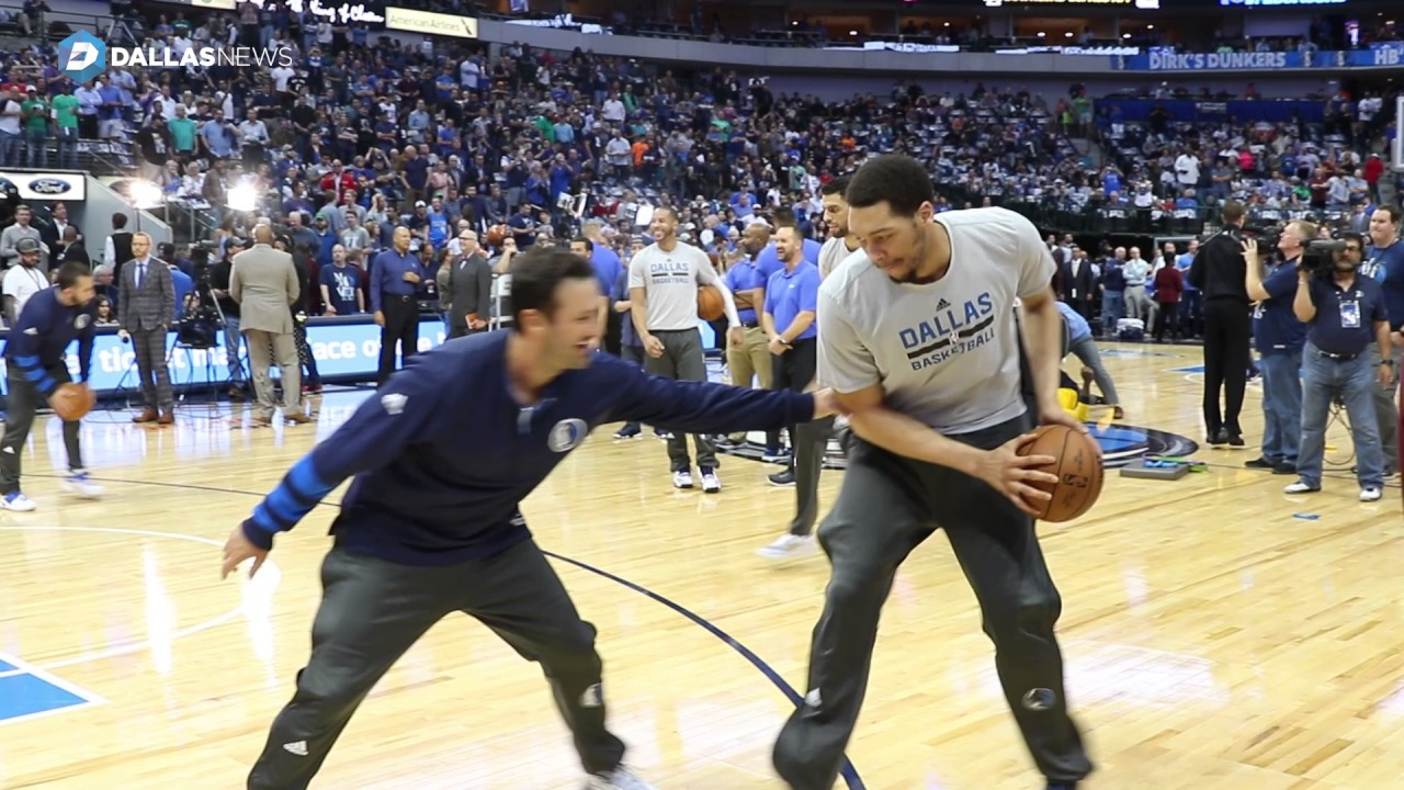 Tony Romo warms up with the Dallas Mavericks