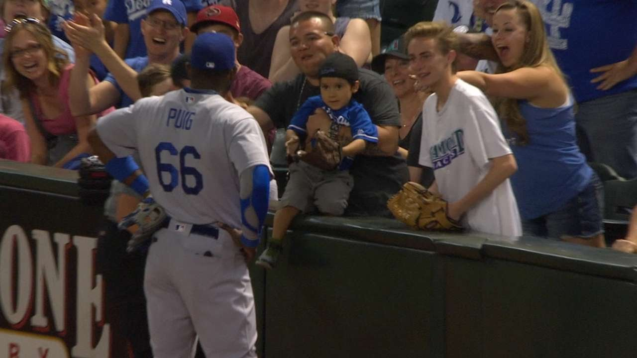 Yasiel Puig attempts to give a young fan a ball 2 times, 3rd time is the charm