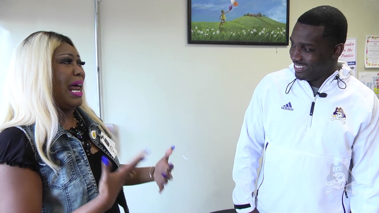 East Carolina football coach surprises mom & son with football scholarship for Mother's Day