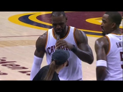 LeBron James pretends to drink a beer after demolishing Toronto