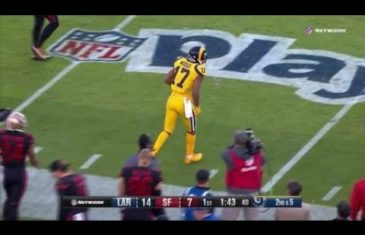 Robert Woods tip-toes in bounds during backward catch