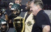 LaDainian Tomlinson presents DeSoto High School with Peanut Bowl Trophy