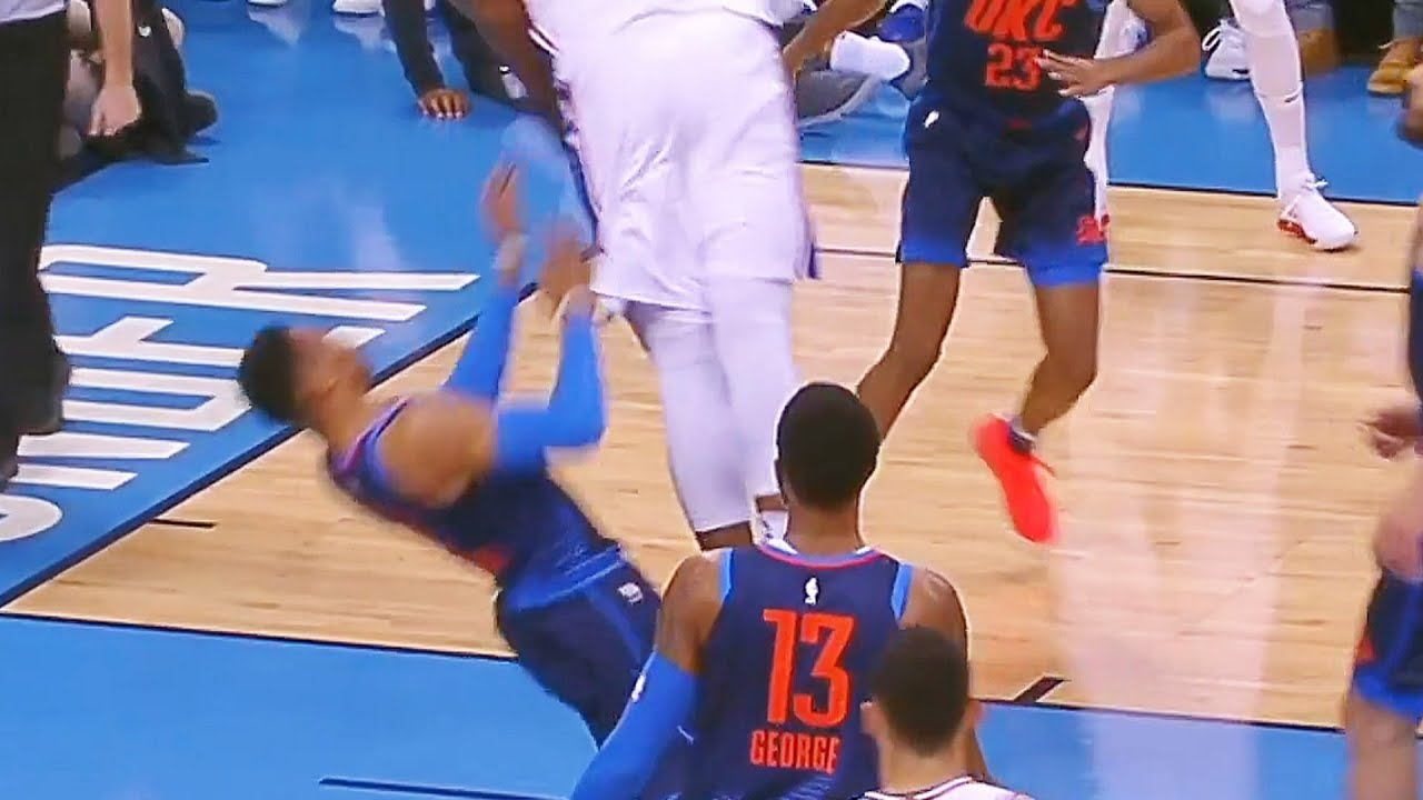 Joel Embiid stuffs one home over Russell Westbrook