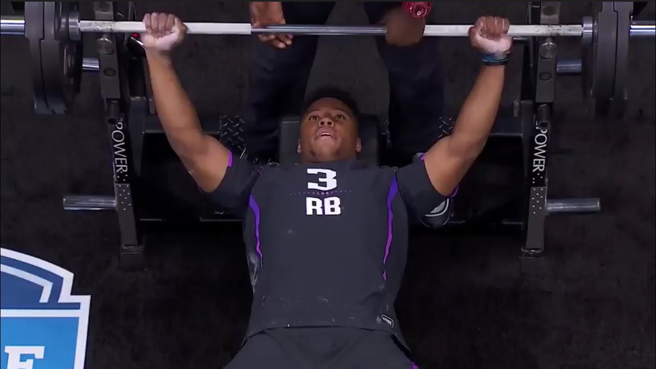 Saquon Barkley puts in work on the bench press before the combine