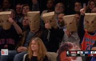 Knicks fans wear paper bags on their heads
