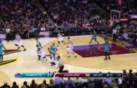 LeBron James throws down a half court alley-oop pass from JR Smith