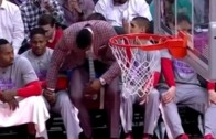 Awkward: Dwight Howard touches Isaiah Canaan in groin area