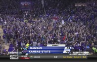 Kansas State court storms after a win versus rival Kansas