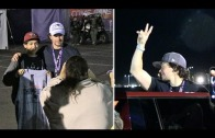 Mark Wahlberg gives a fan his Super Bowl hat after the game