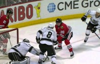 Brandon Saad hit into a sandwhich by Drew Doughty & Kyle Clifford