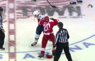Drew Miller appears to punch the St. Louis Blues logo off the helmet of Lindbohm