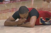 Eric Gordon breaks his tooth after taking a hard fall