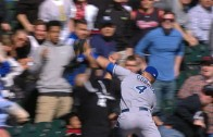 Alex Gordon dives into the stands to make catch