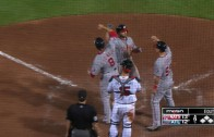 Dan Uggla crushes a three-run home run to deep left to mount comeback
