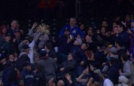 Fan snags a foul ball with bucket of popcorn