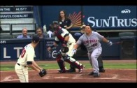 Mets' Bartolo Colon punches out an RBI single & loses helmet