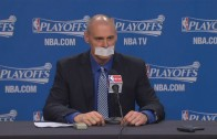 Rick Carlisle covers his mouth with tape in press conference