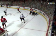 Ryan Reaves pulls a tooth out on the bench after taking a hit