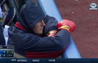 Trevor Bauer sports boxing gloves in dugout