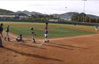 Youth baseball player impressively hurdles catcher