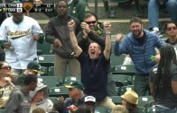 Fan goes ballistic in celebration after snaring foul ball