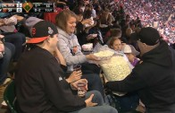 Giants fan shares big bag of popcorn in the stands