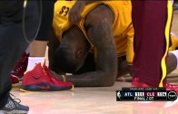LeBron James falls to the floor after the Cavs win Game 3 in OT