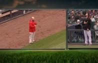 Phillies' Sean O'Sullivan & Rockies' Boone Logan engage in a standoff