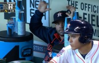 Jose Altuve keeps busy in the dugout as he stacks drinking cups