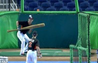 Justin Nicolino drops down bunts with giant bat