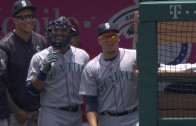 Robinson Cano jokingly wears catcher's mask in the dugout