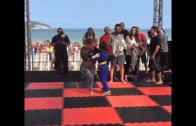 Cute: A young fan sprints over to Ronda Rousey for a hug