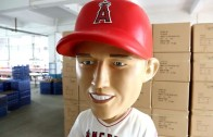 Mike Trout signs life-size bobblehead of himself