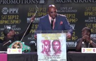 Floyd Mayweather takes a selfie on a selfie stick during press conference