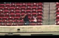 Nothing He Can't Do: JJ Watt slings a deep pass to a fan in the upper deck