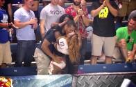 LFL player kisses a fan after scoring a touchdown