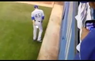 Derek Holland wipes his rear with a Blue Jays rally towel
