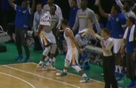 Steph Curry high fives a teammate before the shot even goes in
