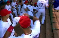 Elvis Andrus jokes around with Prince Fielder in the dugout