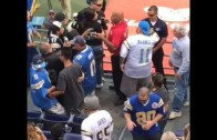 Oakland Raiders fan & San Diego Chargers fan separated by security